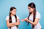 Close up photo two people brown haired mum small little daughter hands arms raised aggressive fighting explaining mistakes sick depression wear white t-shirts isolated bright blue background