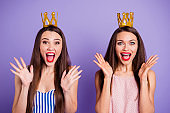Close up portrait two people beautiful she her models chic ladies hands arms palms air power status gold crowns head yelling wear summer colorful dresses isolated purple violet bright background
