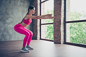Profile side view of nice beautiful graceful attractive thin lady doing situps in modern loft industrial interior style indoors