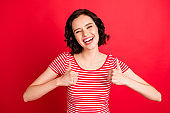 Photo of overjoyed rejoicing woman having just found money lying on ground while isolated with red background