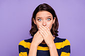 Close up photo beautiful amazing she her lady hiding mouth hands arms oh no expression eyes full fear know rumours speechless wear blue yellow striped pullover isolated violet purple background