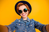 Close up photo funny funky foxy she her lady make take selfies speak tell skype friends wear specs vintage hat casual striped t-shirt jacket jeans denim isolated yellow bright background