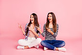 Look sales. Portrait of impressed astonished hipsters choose decide give feedback get information way notice discount demonstrate excited wear checkered shirts denim isolated pink background