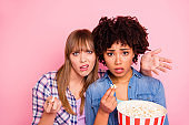 Close up photo two diversity she her ladies different race skin open mouth oh no awful film food pop corn wtf face wear casual jeans denim checkered shirt clothes outfit isolated pink background