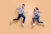 Full size profile photo of two people crazy lady guy jumping high opposite rushing men's women's stores shopping wear casual clothes isolated beige background