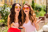 Close up photo cute cheerful teens teenagers best bloggers students hairstyle people travel trip long hair stroll blog message video call use apps read news react colorful specs spring clothing town