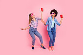 Full length body size view portrait of two person nice attractive cheerful cheery girls in casual checkered shirt dancing having fun isolated over pink pastel background