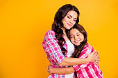 Close up photo two people funny brown haired she her ladies mum mommy small little daughter hold each other hands arms close lovely wear casual pink checkered plaid shirts isolated yellow background