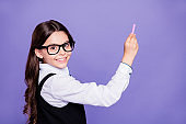 Close-up portrait of nice attractive smart clever intellectual diligent cheerful wavy-haired pre-teen girl writing example copy space class work isolated over bright vivid shine violet background