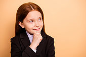 Close-up portrait of her she nice attractive lovely dreamy cheerful cheery sweet pre-teen girl wearing formal wear science knowledge learning isolated over beige pastel background