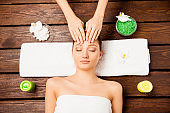 Top view of young woman laying in spa salon relaxing having spa procedures