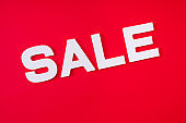 Photo of big white inscription sale isolated over bright red color background dedicated to new year upcoming prices low