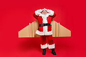 Full length photo of funky retired santa claus ready to start travel journey air flight correct his craft aviation glasses wear black belt cap hat boots isolated over red background
