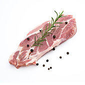 fresh raw pork neck meat pepper and rosemary isolated on white background