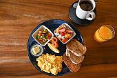 Big breakfast with eggs, fruit and bread