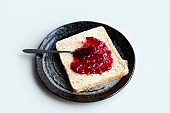 Delicious morning toast with raspberry jam confiture on Japanese ceramics plate Perfect home breakfast