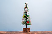 Christmas tree in miniature with decorations and plenty of copy space