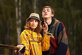 Happy young fashion hipster couple in love outdoor
