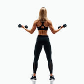 Beautiful Fitness Woman Exercise With Dumbbells