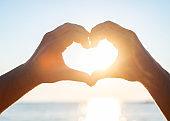 Human hands makes shape of heart