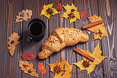 Croissant, coffee, leaves and spice