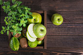 Set of green fruits for healthy diet and detox: apple, lime, kiwi, mango, carambola and mint.