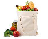 Reusable shopping tote bag full of various groceries.