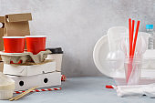 Eco-friendly paper packaging and plastic disposable tableware.