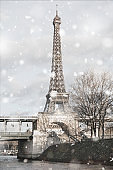Eiffel Tower in Paris, France in snowstorm