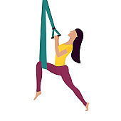 Girl doing fly yoga with aerial hammock