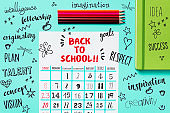calendar, pencil crayons and text back to school