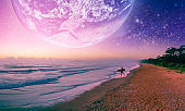 Fantasy landscape of surfer silhouette  walking on the beach of alien planet. Elements of this image furnished by NASA