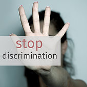 text stop discrimination and woman asking to stop