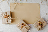 Vintage gift, present boxes with bow on the wooden background pastel. Flat lay. Close up shot a small handmade gift. Gift wrapping. Postcard with a place for text.
