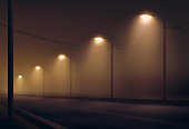 Vector illustration of road lit by lanterns in the fog the night. Street lighting in warm colors