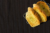 Garlic and herb bread slices on the table