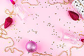 Christmas pink ornament flat lay frame with confetti
