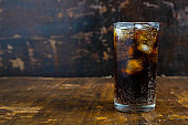 Cola drink, black soft drinks in a glass on the table