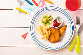 Kid's meal - chicken strips, fries, salad, corn and ketchup