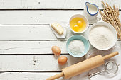 Rustic kitchen - dough recipe ingredients on white wood