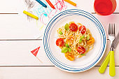 Kid's meal (dinner) - spaghetti with cherry tomatoes and basil