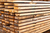 stack boards warehouse of building materials high stack end background natural material