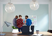 Diverse team of creative millennial coworkers in a startup brainstorming strategies in a modern agency