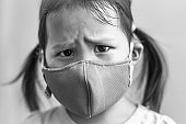 Person wearing a mask for protection of bad air pollution. Environmental health.