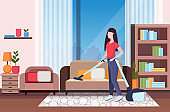 housewife using vacuum cleaner girl vacuuming couch doing housework housekeeping cleaning service concept modern living room interior full length flat horizontal