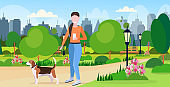 woman walking with dog using smartphone social media network communication digital gadget addiction concept city urban park landscape background flat full length horizontal