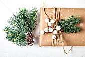Merry Christmas and happy New year. Mockup with postcard and branches of a Christmas tree on white background.Background with copy space. Selective focus. Top view. Christmas background.