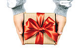 Christmas gift in child's hands isolated on white background.