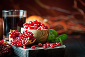 Ripe pomegranate fruit on a old black wooden vintage background. Selective focus.