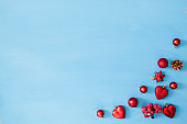Christmas background. Blue wooden plank with red christmas decorations